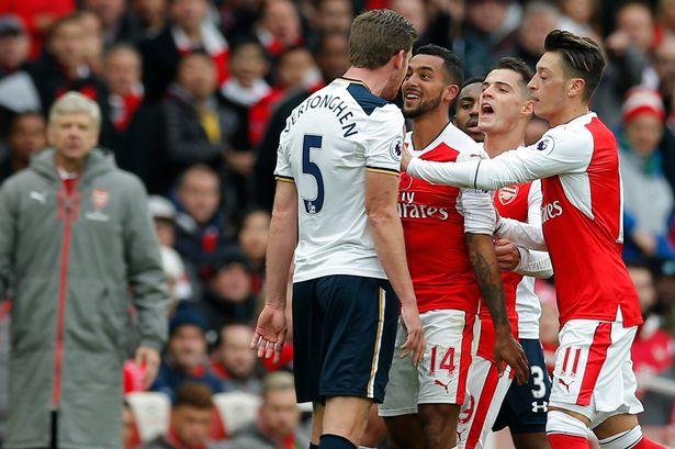 Tottenham-Jan-Vertonghen-clashes-with-Arsenals-Theo-Walcott